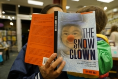 Mother and child reading The Snow Clown - large file